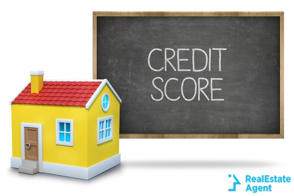 credit score text on blackboard with a 3d house