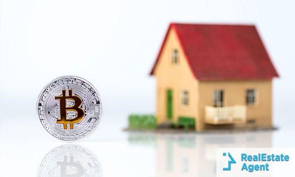 a bitcoin cryptocurrency with a real estate property on the background