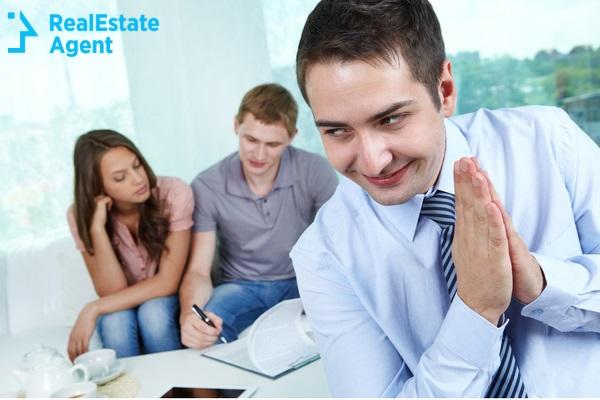 evil real estate agent being glad