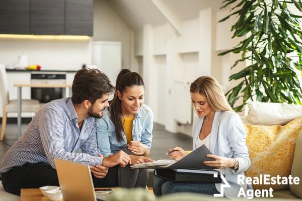 femal real estate agent offer life insurance doc