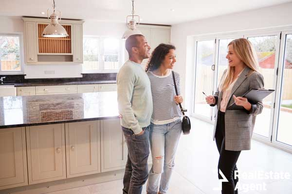 female realtor showing coupe interested in buying