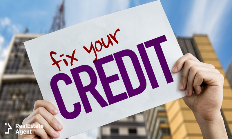 Person holding up a fix your credit sign