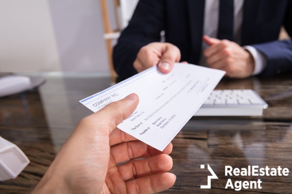 giving cheque to collegue