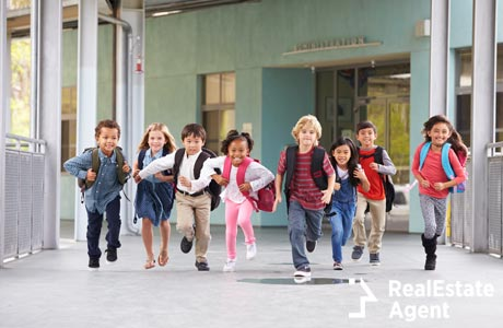 group of elementary school kids running