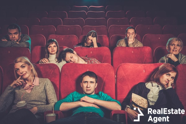 group of people watching boring movie