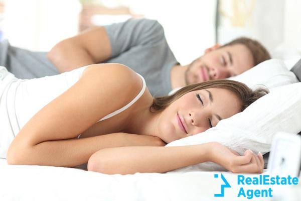 happy couple sleeping in comfortable bed