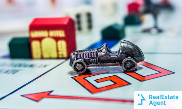 How to buy a house quickly race with a monopoly car on a real estate board