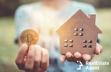 image of a little house and cryptocurrency symbol