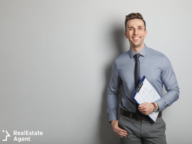 male real estate agent in grey background