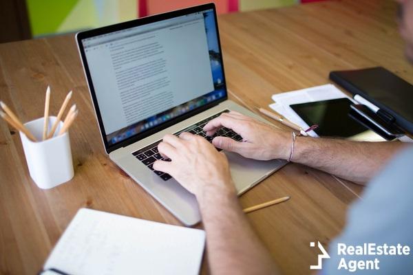 man business plan writing on laptop