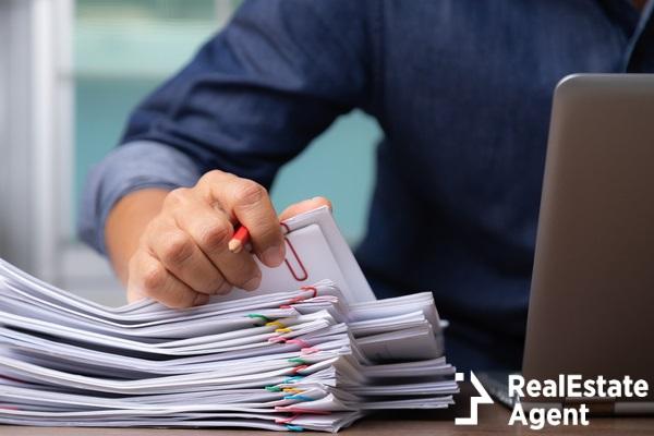 man picking documents