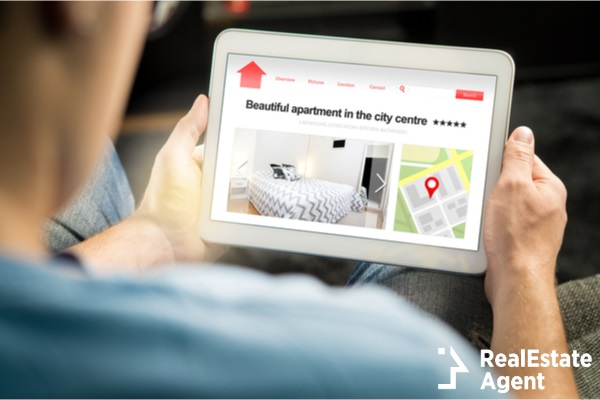 man search for apartments on a tablet