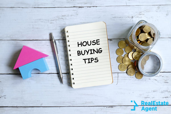 notebook written with house buying tips