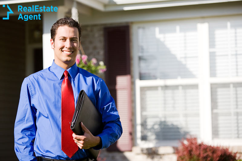 real estate agent in front of a house