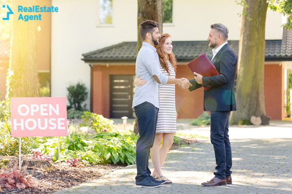 real estate agent meeting homebuyers at an open house