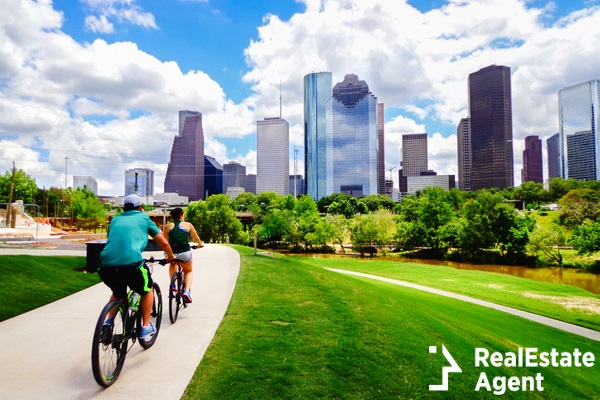 riding bike on paved trail in houston park