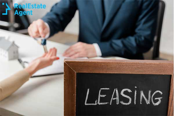 Leasing concept with businessman handing keys