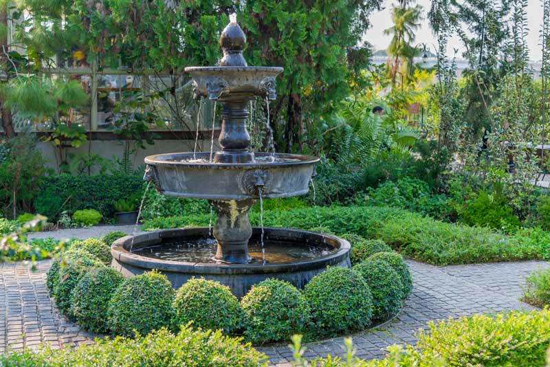 tiered outdoor fountain in a garden