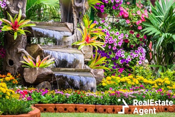 waterfall flow and vivid flowers