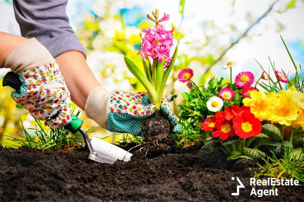 woman wearing pretty gloves as she is gardening