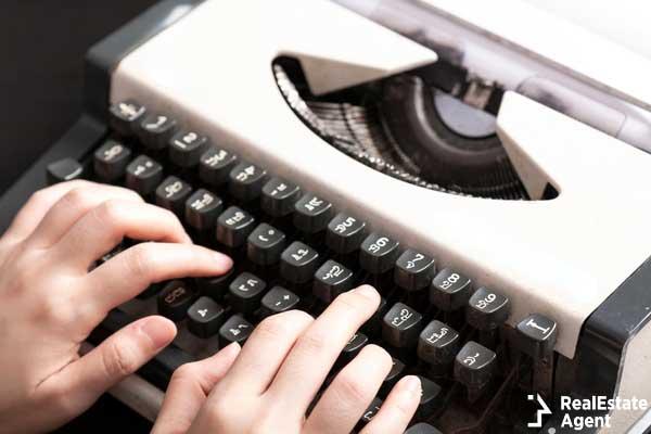 woman typing on an old thai typewriter