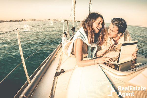 young couple on a sailboat