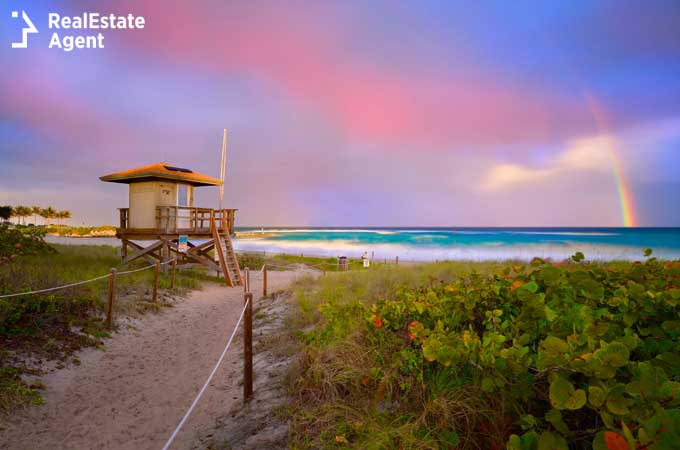 Boca Raton beach view with a beautiful rainbow over the ocean