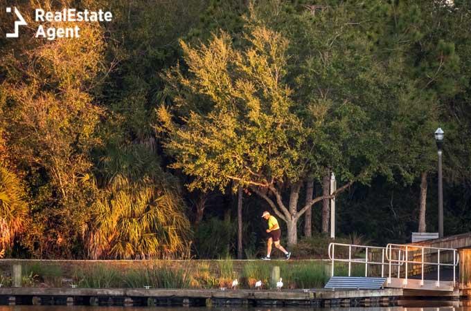 lakewood ranch florida a senios man jogs along lakeside