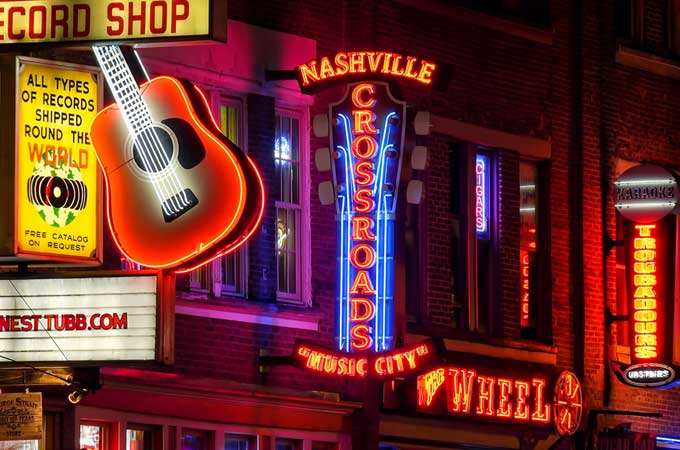 Neon signs at night along Broadway Street in Nashville Tennessee